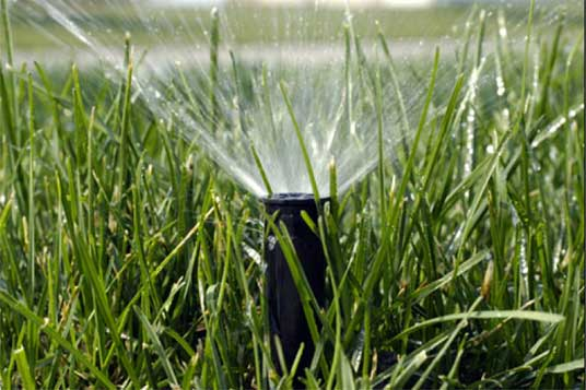 Water Sprinkler System on in the grass