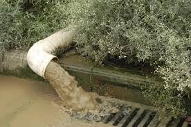 Water draining from pipe to drainage ditch