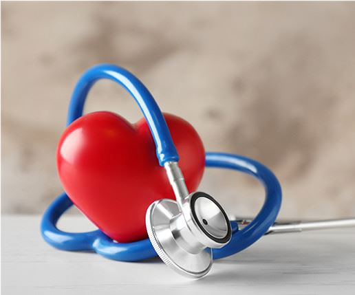 Stethoscope around heart shaped stress ball